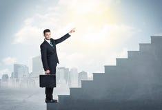 Businessman climbing up a concrete staircase concept Stock Images