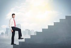 Businessman climbing up a concrete staircase concept Royalty Free Stock Photos
