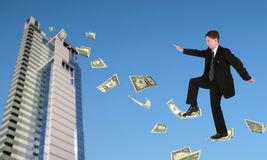 Businessman climbing up on dollars Royalty Free Stock Photo
