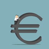 Businessman is climbing up on euro currency symbol Royalty Free Stock Image