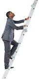Businessman climbing up ladder Royalty Free Stock Photo