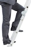 Businessman climbing up ladder Royalty Free Stock Photos
