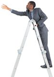 Businessman climbing up ladder Royalty Free Stock Images