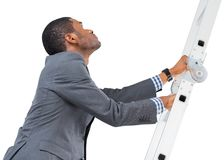 Businessman climbing up ladder Stock Photo