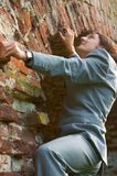 Businessman climbing the wall Stock Photos