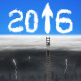 Businessman climbing on wooden ladder for 2016 arrow sign clouds Royalty Free Stock Photography