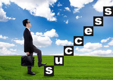Businessman climbs the success stairway Stock Images