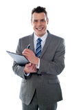 Businessman with clipboard Royalty Free Stock Photos