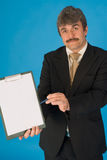 Businessman with clipboard Royalty Free Stock Images