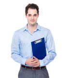 Businessman with clipboard Stock Photo
