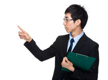 Businessman with clipboard and finger point aside Royalty Free Stock Images