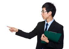 Businessman with clipboard with finger point aside Stock Photography