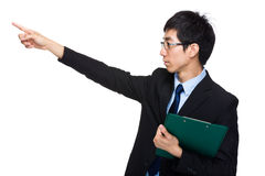 Businessman with clipboard and finger point out Stock Photo