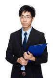 Businessman with clipboard Stock Images