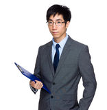 Businessman with clipboard Royalty Free Stock Image