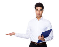 Businessman with clipboard and open hand palm Royalty Free Stock Photo