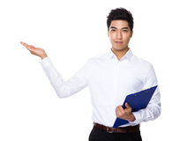 Businessman with clipboard and open hand palm Stock Photography
