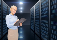 Businessman with clipboard over server room Royalty Free Stock Photography