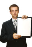 Businessman with a clipboard and a pen, isolated Royalty Free Stock Image