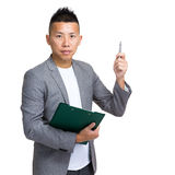 Businessman with clipboard and pen point out Royalty Free Stock Photos