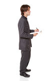 Businessman - clipboard questionnaire Stock Photography