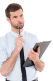 Businessman with clipboard. Stock Photo
