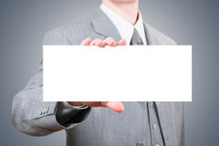 Businessman showing blank big card Royalty Free Stock Images