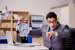 The businessman with clock failing to meet deadlines Royalty Free Stock Photos