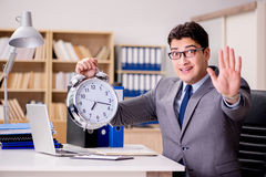 The businessman with clock failing to meet deadlines Stock Image