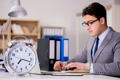 The businessman with clock failing to meet deadlines Stock Photography