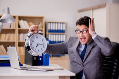 The businessman with clock failing to meet deadlines Stock Photo