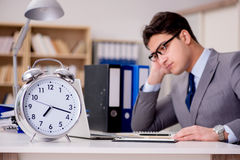The businessman with clock failing to meet deadlines Stock Photos