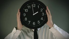 Businessman with clock in front of his head stock video footage