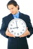 businessman clock holding uncomfortable Στοκ εικόνες με δικαίωμα ελεύθερης χρήσης