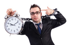 Businessman with clock isolated Stock Images