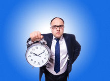 Businessman with clock isolated on white Royalty Free Stock Photos