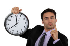 Businessman with a clock Stock Image