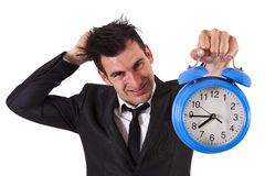 Businessman with clock Royalty Free Stock Photos