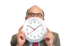 Businessman and clock. Stock Photography