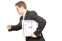 Businessman with clocks. A man in business suit posing for the camera Stock Photos