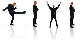 Businessman Clone. Dancing happy winner business man on white poses Stock Images