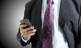 Businessman. Close up of businessman using mobile phone ,   background Royalty Free Stock Images