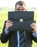 Businessman closes black briefcase Stock Image