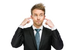 Businessman closes his ears Royalty Free Stock Photography
