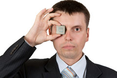 Businessman closes one eye, a processor Royalty Free Stock Photos