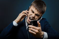 Businessman. Closeup portrait  the  beautiful  businessman careerist in costume,  call and angry cry Stock Image