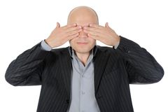 Businessman closing his eyes Stock Images