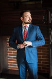 Businessman clothes corrects office Stock Images