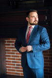 Businessman clothes corrects office Stock Photography