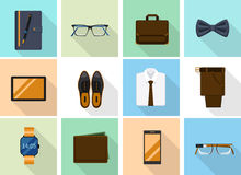Businessman clothes and gadgets icons in flat Stock Photos